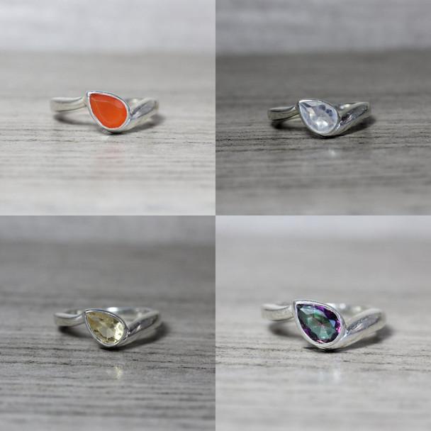 Sideways Pear Cut Bezel Set Bypass Shank Ring Teardrop Gemstone Design