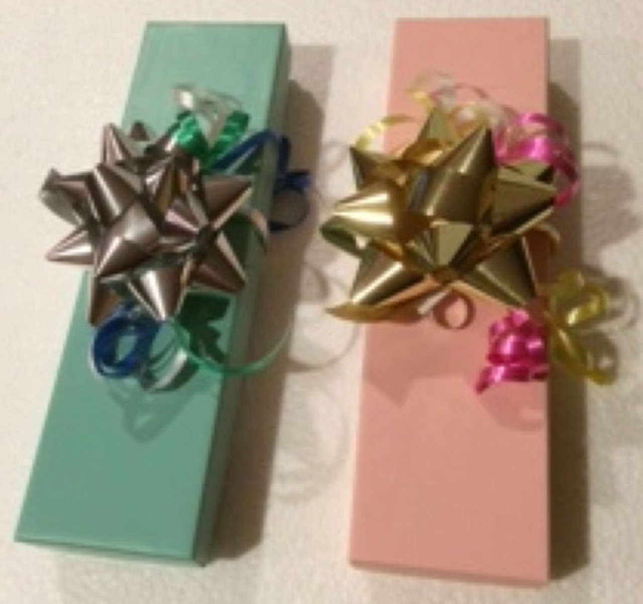 1f4e80eda9100 Two sturdy gift boxes with a pad of soft cotton on the inside hold 1-