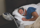 Man sleeping with ResMed Swift LT Nasal Mask