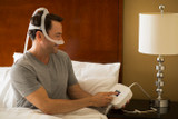 Young man wearing the Philips Respironics DreamStation Go Auto CPAP