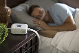 Man sleeping with the Philips Respironics DreamStation Go Auto CPAP