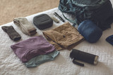 Philips Respironics DreamStation Go Auto CPAP beside folded clothes