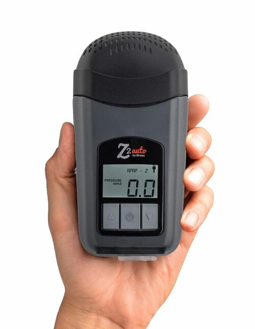 Hand holding a Breas HDM Z2 Auto Travel CPAP Machine