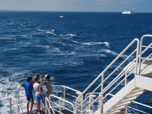 Boys on school holidays as the return ferry passes (Sorrento)