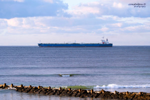 On a cold winter overcast morning the Oklahoma sails past Pt Lonsdale front beach (Pt Lonsdale)