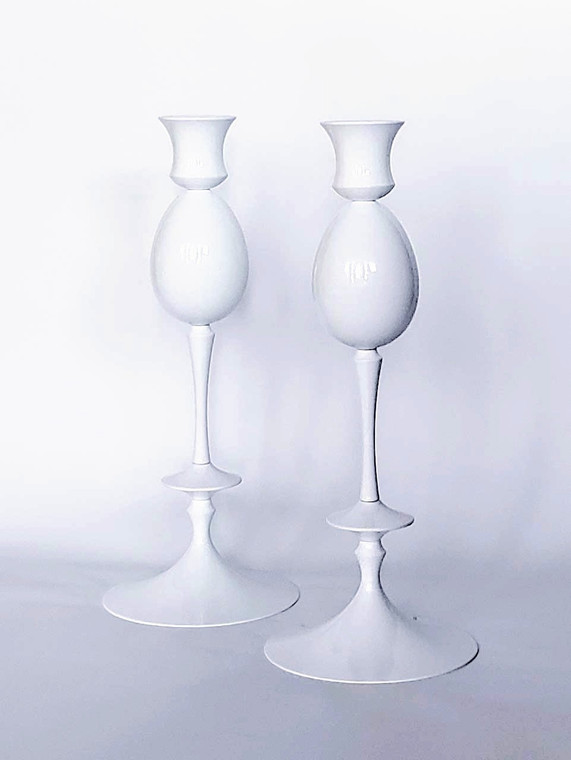 Set of two candlesticks with keepsake cremation urns  in egg shape. Both are finished in Porcelain White finish.