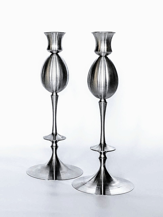 Set of two candlesticks with keepsake cremation urns  in egg shape. Both are finished in Matt Hematite finish.