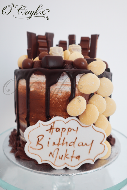 Chocolate Sweetie Drip cake  Please note that types of chocolates/sweeties used, are subject to availability, and therefore might not look exactly like the image represented
