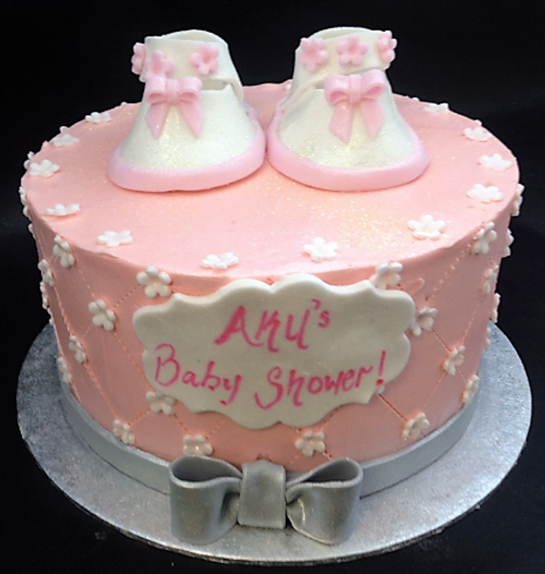 Pink Buttercream cake with booties