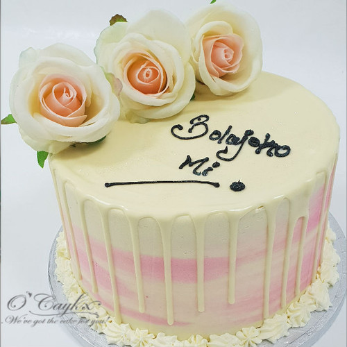 White chocolate Drip cake with silk roses