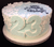 Round Blue Cake with White Petals and Pearls