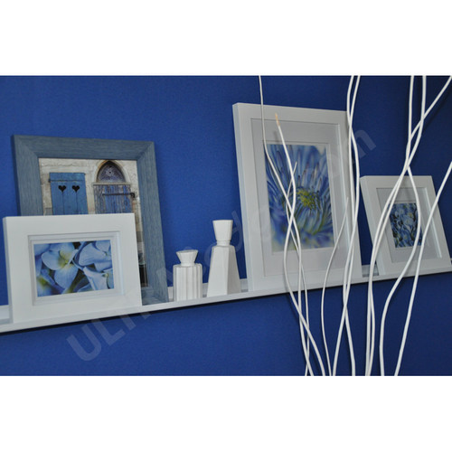 white ledge with frames