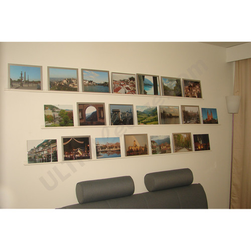 three 6' white ledges with picture frames