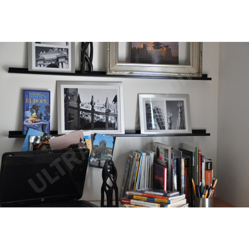 3ft black ledges with frames and books