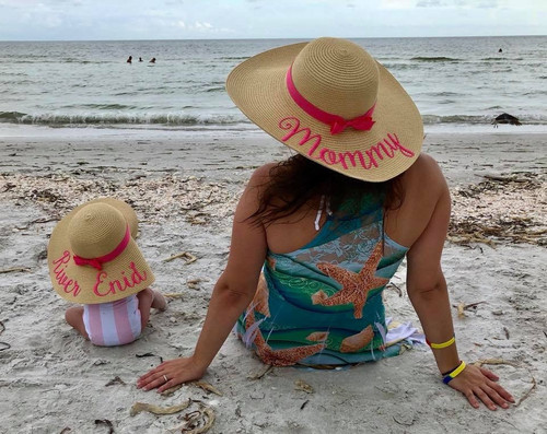 Personalized mommy and daughter matching beach hats with daughters first name