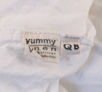 Yummy Linen lable showing the Queen Size Sheets tag on the pure white flax Linen sheets.