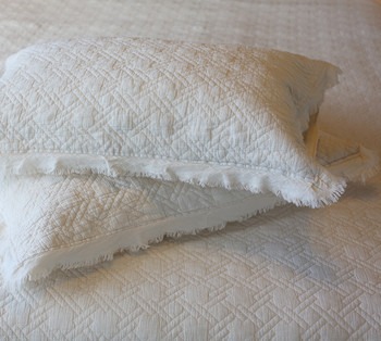 Vintage frayed edging lends a delicate luxurious touch to the set.