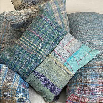 Bobo Textural cushion covers in vintage cloth of the shades, greeen, blue, and purple. Layers of fine sari cloth have been hand stitched together in to a Kantha quilt. From their first up-cycle they are then made into our cushion covers.