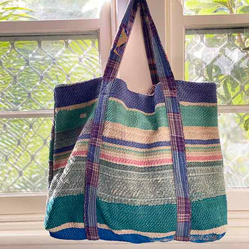 Upcycled cotton kantha shopping tote bag , with two strong cloth straps that wrap around the bottom of the bag. Gentle and soft retro colours of faded lilac, and blue, in a striped pattern. Patchwork style.