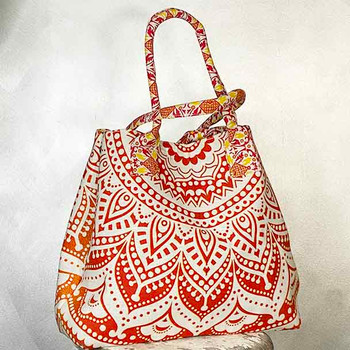 Vibrant red, yellow and orange mandala pattern cotton tote bag, with two straps.