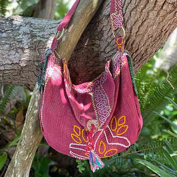 hand embroidering features on this vintage cloth kantha stitch shoulder bag in dusty magenta tones.