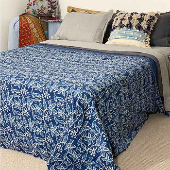 showing the full quilt over a queen size bed.
