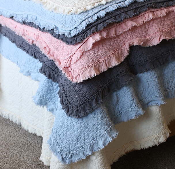 The four colours of our coverlets. Charcoal, Pink, Baby Blue and Cream.