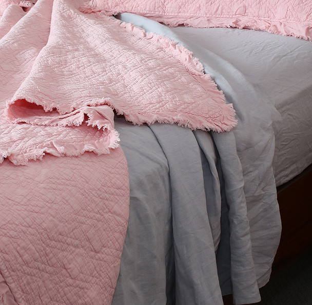 Musk Pink bedspread with 180 GSM pure linen sheets in Dove Grey.