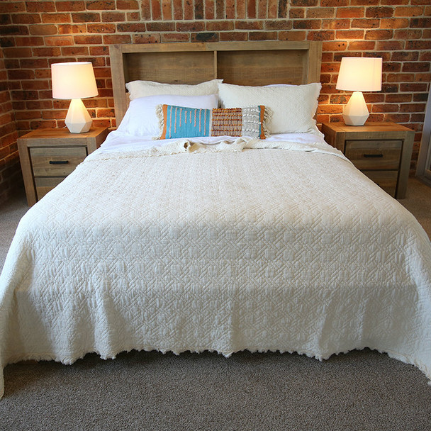 Ivory Cotton  quilted bedspread. Pictured with a king on queen.