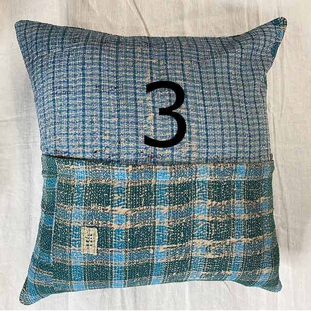 Checkered pattern of Scottish looking cloth design in greens and blues over a 50 x 50 cm cotton cushion cover.