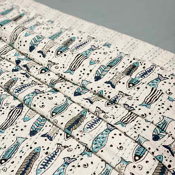 Coastal sea colours with kantha stitched stylised fish design on a white background and featuring kantha hand stitching.