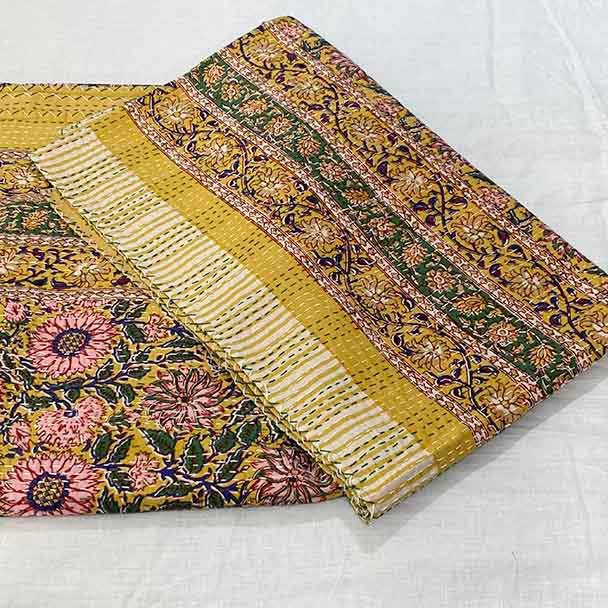 Folded quilt with feature border. Showing close up of the design.