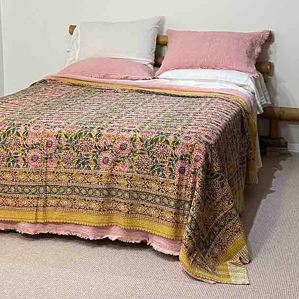 Showing the  quilt on a queen size bed. This style will fit a king bed as well.