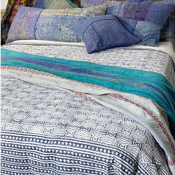 Queen size bed cover with a monochromatic charcoal blue aztec design and diamond shaped border