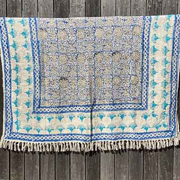 Hand stamped block print throw rug made from hand woven rough cotton. The pattern is in shades of blue and has fringing on either end.