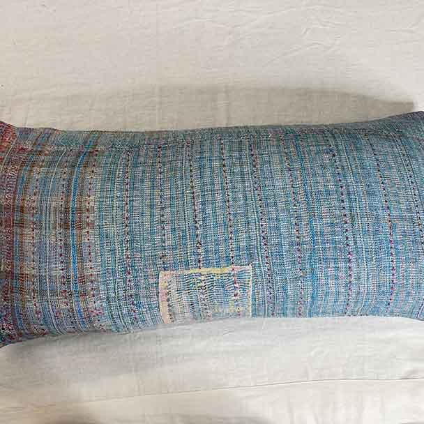 The detail of one of the 100 x 50 cm cushion covers showing the stitching showing up as coloured lines. The depth of texture is due to the top most layers of cotton breaking down to reveal what is underneath.