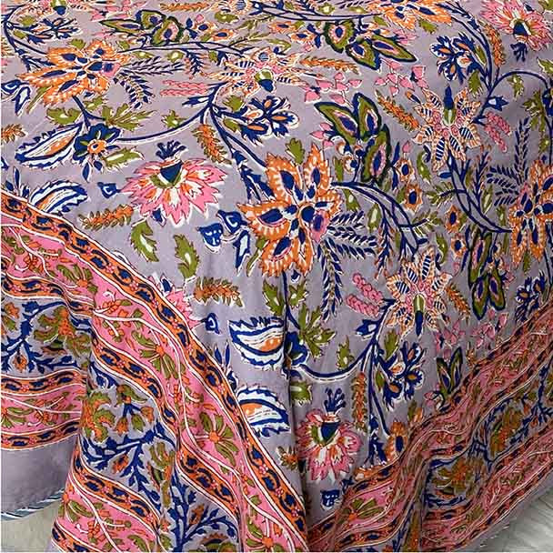 Dusty Lilac super soft quilted cotton floral bed sheet in shades of dusty lilac, orange, green and pink.