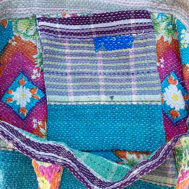 Showing the large internal pocket stitched to the inner lining of the bag. This is also kantha cloth.