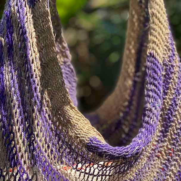 Close-up showing the hand weaving of the bag.