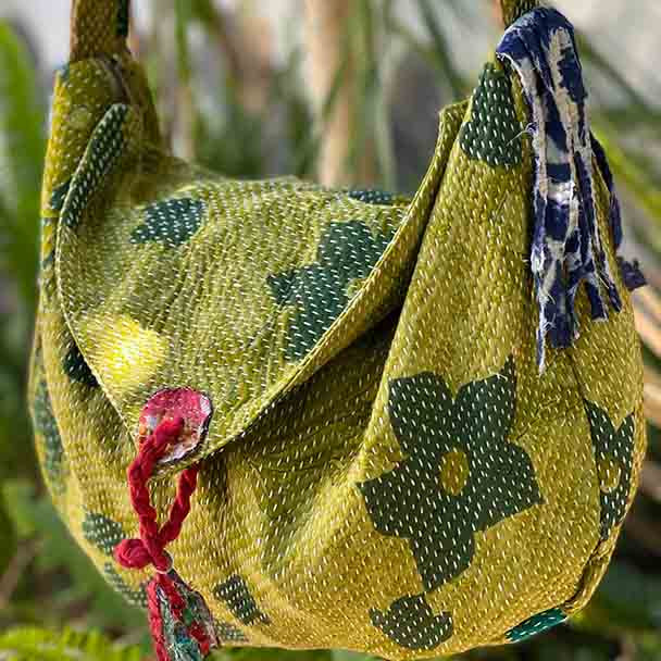 Showing the style of vintage kantha hand stitched cloth in varing greens with feature flowers, aslo in Green.