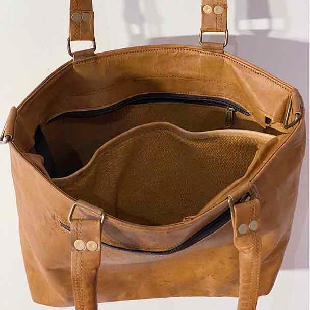 Showing the internal openings of the tote bag with sturdy canvas lining.