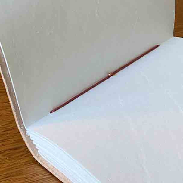 showing the hand binding in the paper.