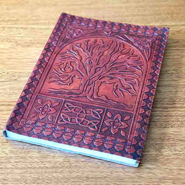 Front cover with the Tree of Life in Mahogany coloured leather.