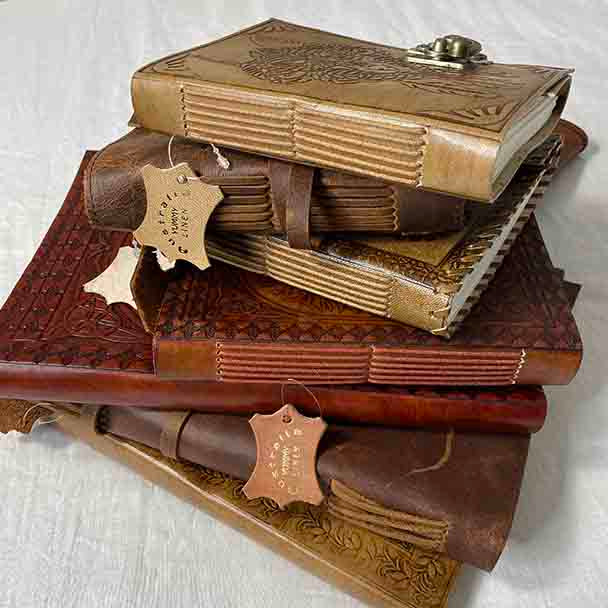 Showing our handmade leather bound book collection.