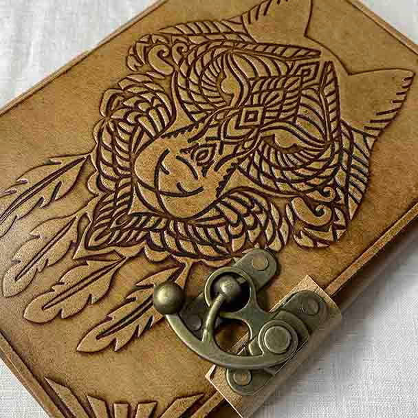 Carved Wolf design on genuine leather with medieval clasp.