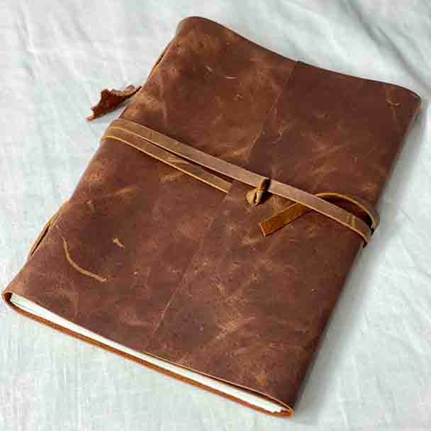 Showing the large A4 size leather medieval style journal.