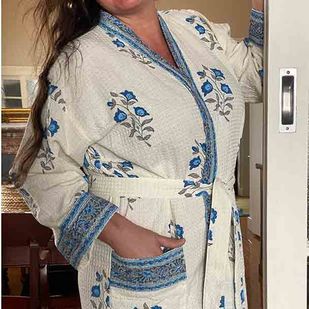 Free size bath or spa robe, white with a blue flower design over the robe. Model is a busty size 16 ladies. Fits ladies 10 to 16 easily.