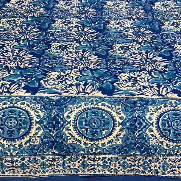 Cotton hand block printed with an intricate indigo blue floral design.