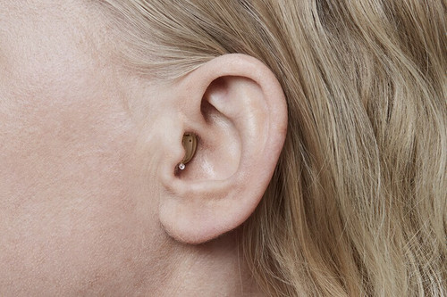 Oticon Opn Invisible-in-the-Canal hearing aid sits deep in the ear canal where no one will notice it. A small plastic removal string is accessible but not noticeable, making removal easy and discreet