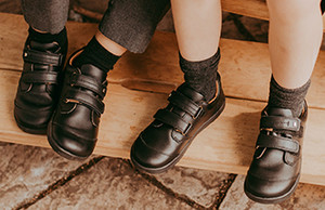 Black sport shoes vs traditional school shoes - which reigns superior?